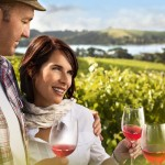 Couple enjoying wine on the Waiheke Island Tour Image by ChrisSisarich