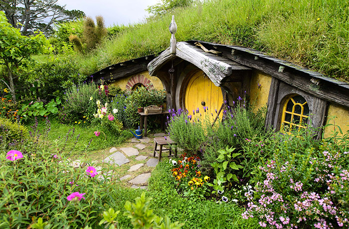 Lush gardens surrounding Hobbit hole in Hobbiton