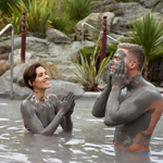 Couple bathing in mud in Hells Gate, Rotorua