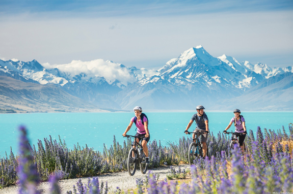 Cycling along Lake Pukaki and Mountains credit Miles Holden